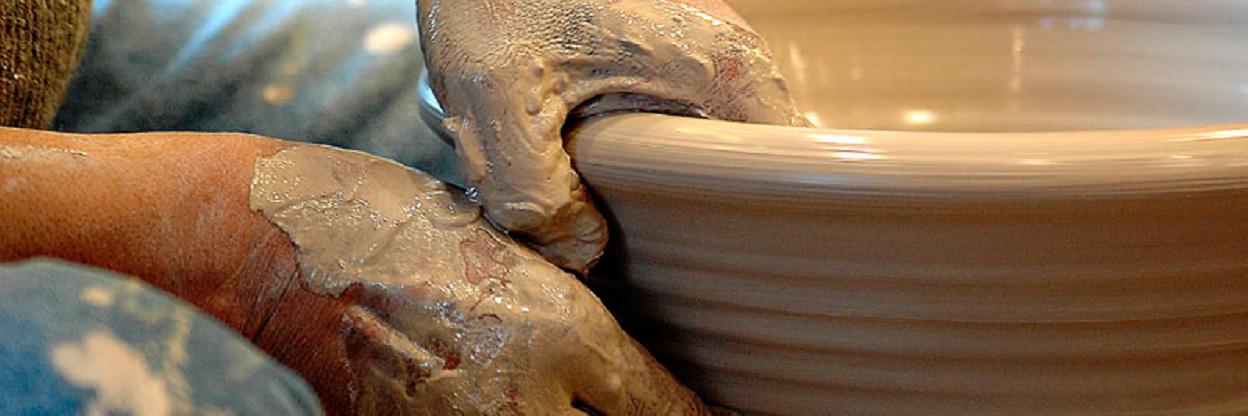 Potter and hands by Alan Kolnik.