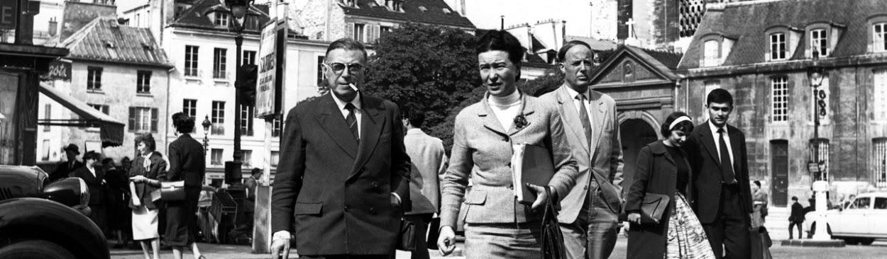Simone de Beauvoir and Jean-Paul Sartre crossing Place Saint-Germain-des-Prés, Paris, mid 1950s. Photo: René Saint Paul.