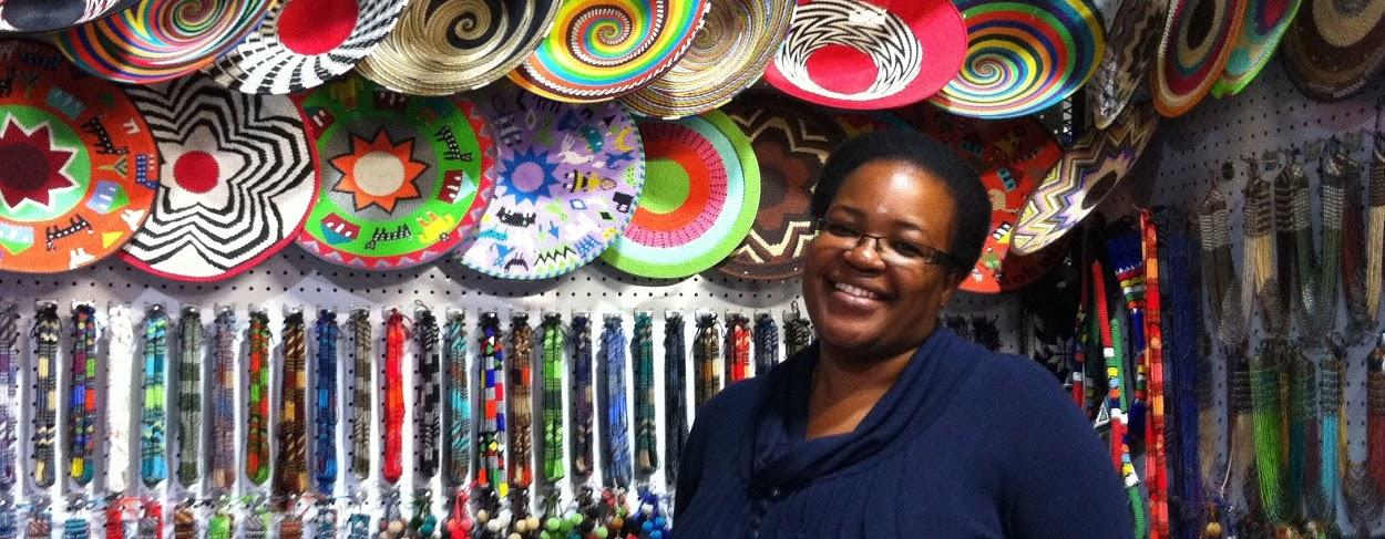 Vendedora em Rosebank Market - Joanesburgo.