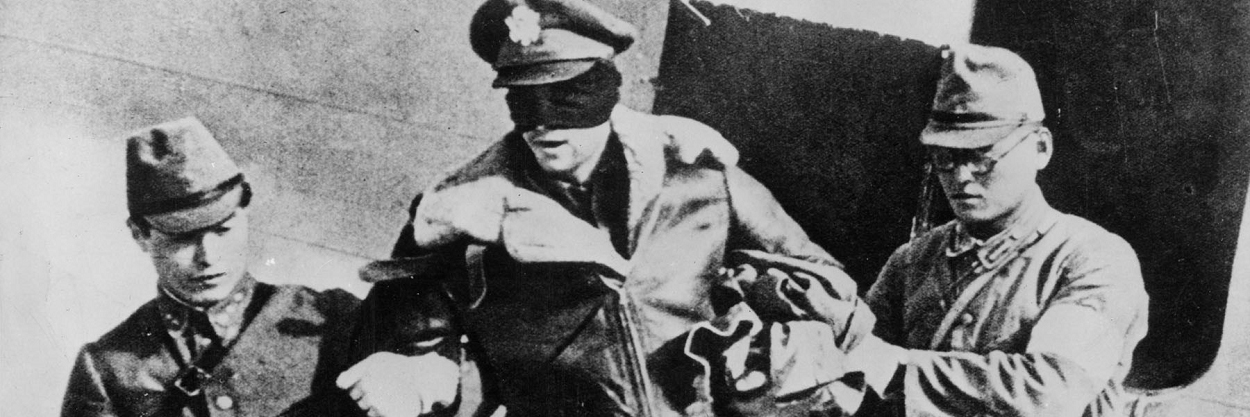 Robert L, Hite - America pilot, blindfolded by his captors, 1942.